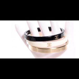 CHANEL Jewelry - Chanel gold black white CC LOGO stacking bracelets